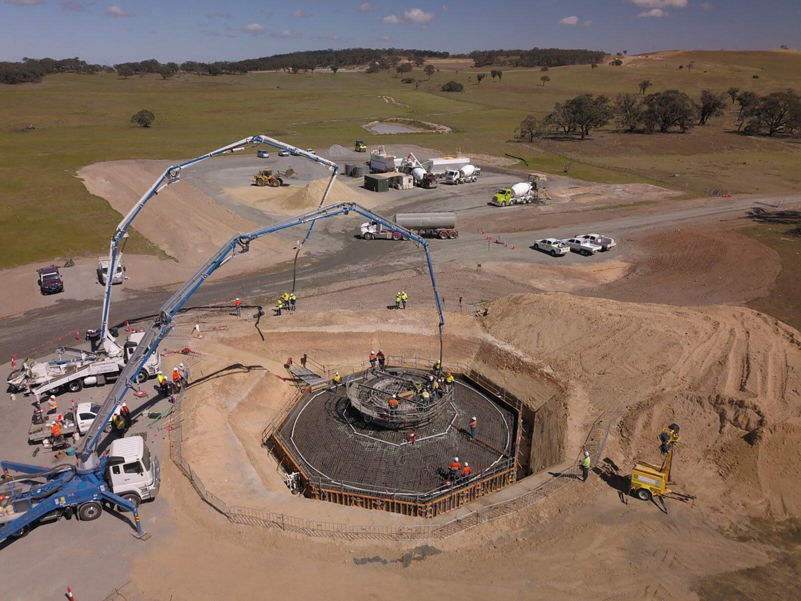 Collector team's first foundation pour and in the background is the mobile concrete batch plant.