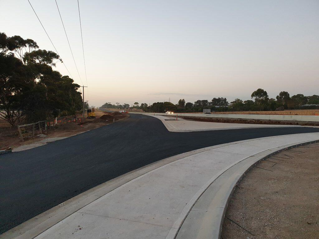 Stage 1 roundabout base and intermediate asphalt layers completed.